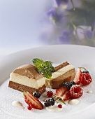 Layered mousse au chocolat, chilled vanilla sauce, berries