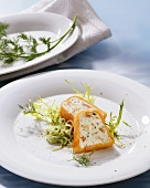 Smoked fish mousse on cucumber salad
