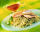 Fried salmon trout on barley risotto with herbs