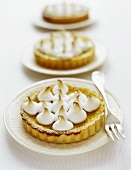 Three tarts with meringue topping