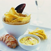 Lobster tail with mustard mayonnaise and vegetable crisps