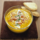 Pumpkin soup with sour cream, paprika and pita rolls