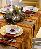 Laid table with autumnal decorations