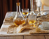 Elegantly laid table with digestif in a decanter