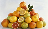A heap of citrus fruit, whole and pieces