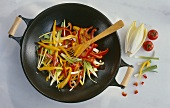 Frying vegetables gently in a wok