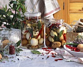Pickled eggs in preserving jars with spices
