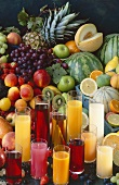 Several glasses of fruit juice and fresh fruit