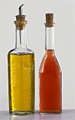 Bottle of raspberry vinegar and bottle of olive oil
