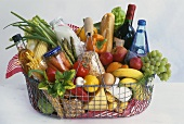 Shopping basket full of different foodstuffs