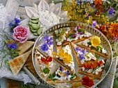 Quark and edible flowers on toast triangles