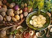 Still life with peeled and unpeeled potatoes