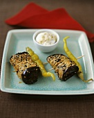 Fried aubergine rolls with sesame seeds