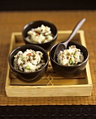 Three small bowls of mashed potato with lentils