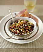 Couscous salad with fruit and nuts, ham