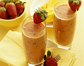 Two mango and strawberry smoothies