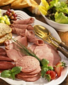 Cold cuts platter with lettuce and baguette