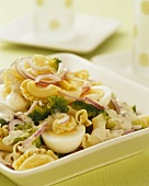 Pasta salad with broccoli, onion, egg and mustard mayonnaise dressing