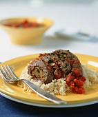 Beef roulades with mushrooms and tomatoes on couscous
