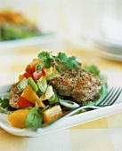 Pork with warm mango and pepper salsa