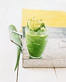 A glass of cucumber, seaweed and Aloe vera shake