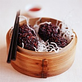 Meatballs with red rice and deep-fried glass noodles