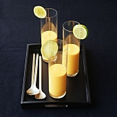 Mango laksa with lime in three glasses