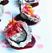 Oyster with tamarillo relish on beetroot