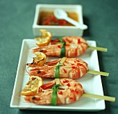 Caramelised prawn skewers with chilli and lemon