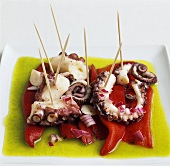 Octopus on red peppers in olive oil