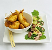 Fried fish in batter with cucumber and shallot salad