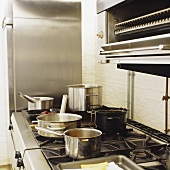Assorted pans on a gas cooker