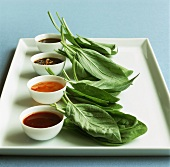 Thai basil leaves with four different dips