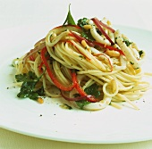 Spaghetti with squid, pine nuts and corriander