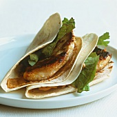 Tortillas filled with chicken breast and cheese
