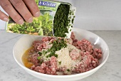 Adding herbs to meatball mixture