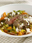 Boiled beef fillet with vegetables and horseradish
