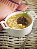 Arroz caldoso (rice soup, Spain) with chickpeas and black pudding