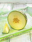Half a melon and a slice of melon