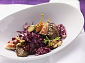 Red cabbage salad with fried duck liver and figs