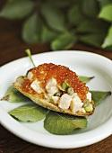 Salmon tartar marinated in elderflower with caviar