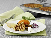 Waffles with caviar, onions and creme fraiche