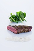 Grilled saddle of venison with anis, cinnamon yogurt and watercress salad