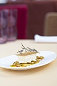 Rosemary parfait with grilled peaches, passion fruit sauce and caramel brittle