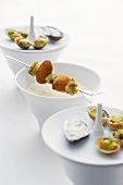 Curry soup with a baked mussel kebab