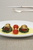 Aubergine roulade with tomatoes on spinach