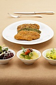 Veal escalope with various salads