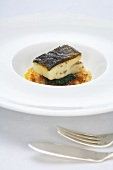 Cod with chard on an apricot and onion gratin