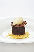 Warm chocolate cake with banana ice cream and glazed bananas