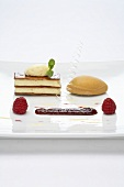 Vanilla mousse in strudel pastry with caramel ice cream and raspberry confit